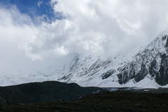 Tilicho peak in the clouds, Nepal Stock Photos