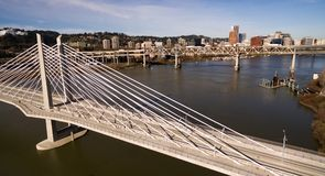 Transit Bridge Carries Buses Trains and Pedestrians over the Willamette stock images