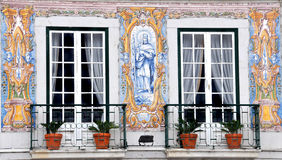Tiling. Exterior of old Portuguese building in Lisbon with ancient ceramic azulejo wall tiles Royalty Free Stock Image