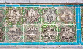 Tiling of mosque Takieh Mo'aven ol-Molk with persian wariors and buildings Stock Image
