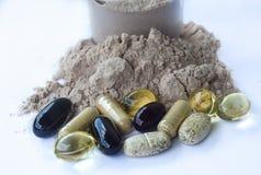 Tillägg - vitaminmineraler, chokladproteinpulver Fotografering för Bildbyråer