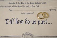 Till law do us part... certificate of marriage and rings Royalty Free Stock Photography