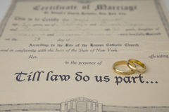 Till law do us part... certificate of marriage and rings Stock Images