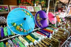 Till salu färgrikt handgjort paraply Arkivbild