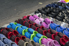 Till salu Rubber sko Arkivbilder
