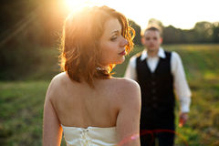 Till you reach me - sunrays plays in the bride's red hair Stock Photos