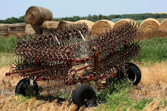 Tillage Implement. Folded up in field in summertime royalty free stock images