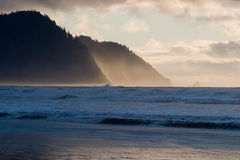 Tillamook Head. On the Oregon Coast at early sunset with the sun catching sea spray Royalty Free Stock Photo