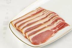 tillbaka bacon Arkivfoto