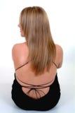 tillbaka blond kvinnligsikt Arkivfoto