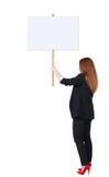 Tillbaka bräde för tecken för visning för siktsaffärskvinna Arkivfoto