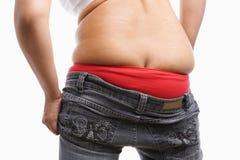 tillbaka fet jeanssida tight till den försökande wearkvinnan arkivbilder