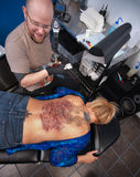 tillbaka full tatuering Royaltyfri Foto