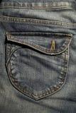 tillbaka jeansfack Arkivbild