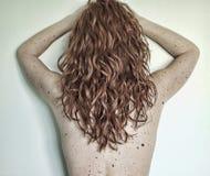 tillbaka kvinna Arkivfoto