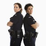 tillbaka kvinnlig polis till royaltyfri bild