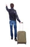 Tillbaka sikt av att peka mannen med resväskan Royaltyfria Foton