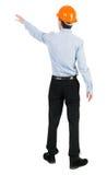 Tillbaka sikt av att peka unga män i skjorta och hjälm Arkivbild