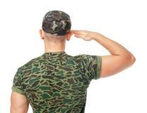 Tillbaka sikt av att salutera för armésoldat Royaltyfri Bild