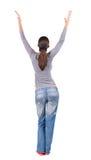 Tillbaka sikt av den härliga kvinnan i jeans Fotografering för Bildbyråer