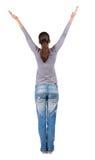 Tillbaka sikt av den härliga kvinnan i jeans Arkivbilder