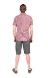 Tillbaka sikt av den unga mannen, i skjorta och att se för kortslutningar Arkivfoton