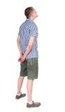 Tillbaka sikt av den vuxna mannen, i skjorta och att se för kortslutningar Arkivfoton