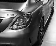 Tillbaka sikt av en Mercedes Benz C 43 AMG 4Matic 2018 avgasrörsystem Bilyttersidadetaljer svart white Arkivfoto