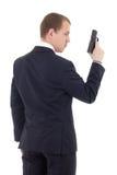Tillbaka sikt av mannen i affärsdräkt med vapnet som isoleras på vit royaltyfri bild