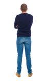 Tillbaka sikt av mannen i jeans Royaltyfria Bilder
