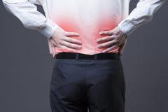 Tillbaka smärta, njureinflammation, knip i kropp för man` s arkivfoton