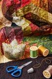 Tillbehör för patchwork på ett täcke Royaltyfria Bilder