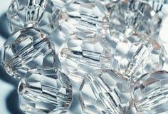 tillbehör små genomskinliga kristaller Arkivfoto