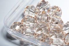 tillbehör små genomskinliga kristaller Arkivbilder