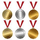 Tilldela medaljer guld, silver och bronsskyddsremsor eller medaljer Arkivfoto