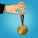 Tilldelade en medalj den första ställevinnaremästaren Arkivbild