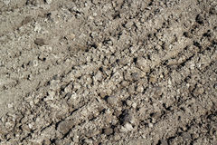 Tilled Earth Background. Tilled brown ground  background at  Croft. Spring Royalty Free Stock Images