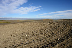 Tilled Soil. Landscape featuring tilled soil from a farmers field Royalty Free Stock Photos