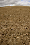 Tilled Soil. Landscape featuring tilled soil from a farmers field Stock Photos
