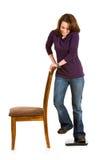 Tillfälligt: Kvinnafuskskala, genom att rymma stol royaltyfri bild