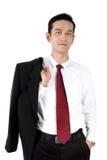 Tillfälligt posera av ung asiatisk affärsman, isolerat på vit arkivfoton