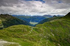 Mountain pass over Carnic Alps main ridge from Italy to Austria Royalty Free Stock Photography