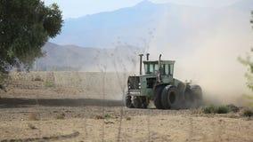 Tilling dry soil stock video