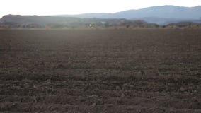 Tilling dry soil stock video footage