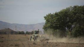 Tilling dry soil stock footage