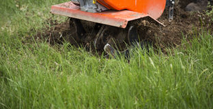 Tilling up the lawn Royalty Free Stock Image