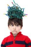 tilltrasslade jullampor Arkivfoto