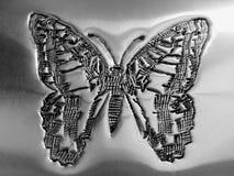 Tillverkad fjäril på silverplattan Royaltyfri Foto
