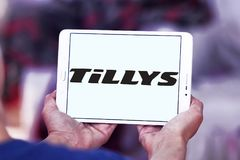 Tillys fashion brand logo. Logo of tillys fashion brand on samsung tablet. tillys is an American retail clothing company that sells a wide assortment of branded royalty free stock image