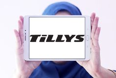 Tillys fashion brand logo. Logo of tillys fashion brand on samsung tablet holded by arab muslim woman. tillys is an American retail clothing company that sells a stock photo